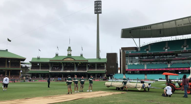 The covers came on early at the SCG on Monday