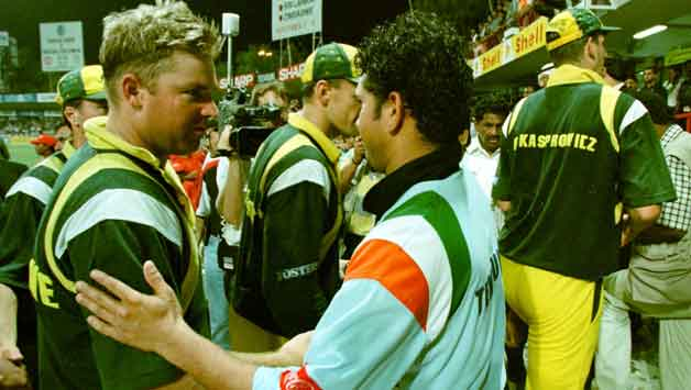 Shane Warne (left), who was in a state of bemused helplessness while at the receiving end of Sachin Tendulkar. shakes hands with the maestro at the end of the match © AFP