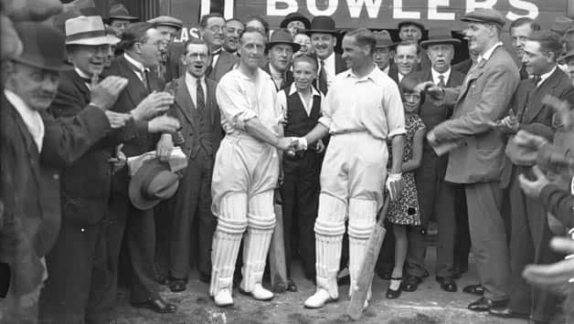 Percy Holmes (left) and Herbert Sutcliffe after breaking the record for first wicket stand © Getty Images