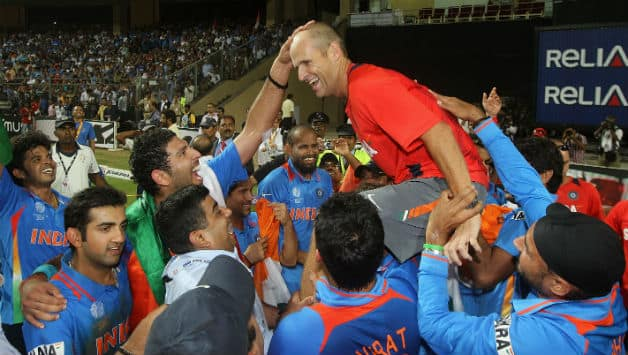 Gary Kirsten, the low-key coach of the 2011 World Cup-winning Indian team, chaired during the victory lap © Getty Images