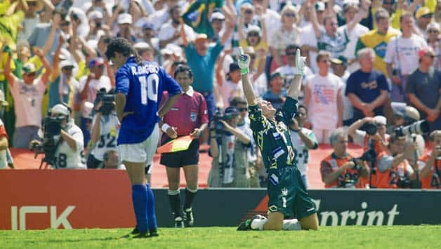 a900a35df26 Roberto Baggio (left) is distraught after missing the penalty that helped  Brazil beat Italy