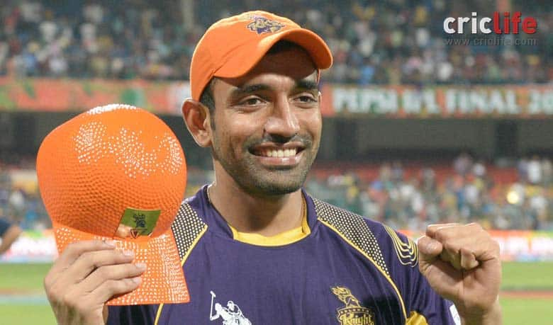 Robin Uthappa poses with his Orange Cap for being the leading run-scorer in IPL 2014. He is only the second Indian batsman after Sachin Tendulkar to do so © IANS