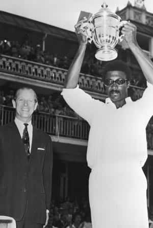 West Indies captain Clive Lloyd with the trophy © Getty Images