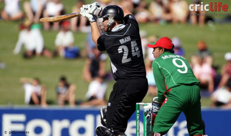 Jacob Oram drives the ball away for four runs during the 1st ODI against Bangladesh at McLean Park