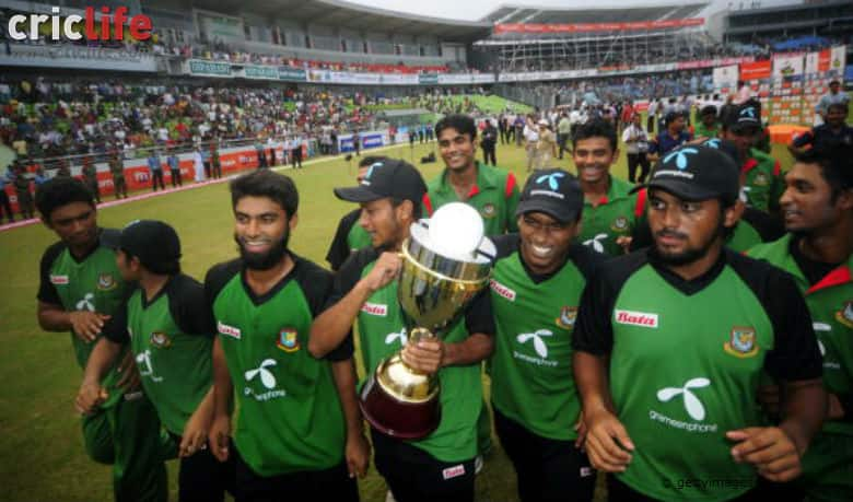 Bangladeshi cricket team celebrate with the champion trophy after winning the last ODI against New Zealand at Sher-e Bangla National Stadium