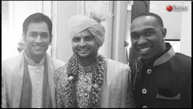Suresh Raina (centre) with MS Dhoni (left) and Dwayne Bravo (right)