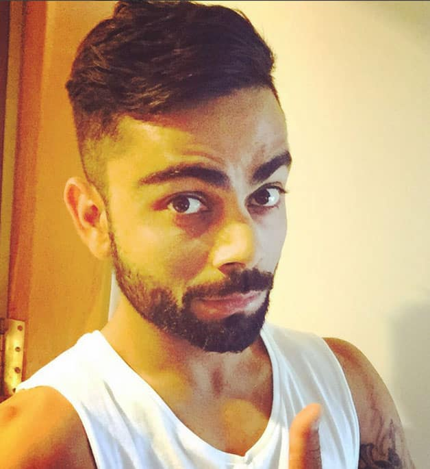 virat koholi hair style photo virat kohli sports new hairstyle ahead of 2nd test 9130