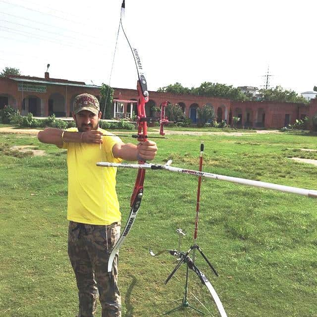 Mohit Sharma trying his hand at archery