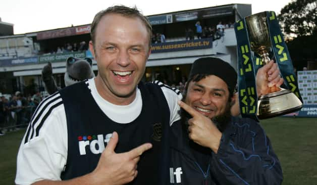 The General and his Titan: Chris Adams (left) celebrates the Championship title with Mushtaq Ahmed © Getty Images