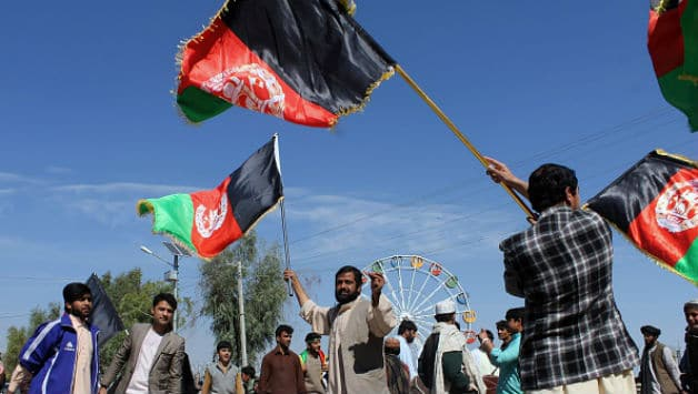 Afghan cricket fans celebrate their national cricket team victory in the World Cup 2015 © AFP