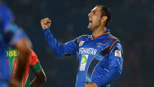 Mohammad Nabi celebrates after claiming final wicket of Rubel Hossain of Bangladesh in 2014 Asia Cup © AFP