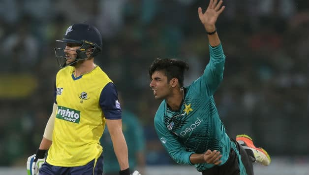 Shadab Khan bowls in series opener vs World XI © AFP