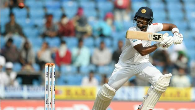 Chandimal scored the second half-century of the innings. He was dismissed for 57 by Ashwin © AFP