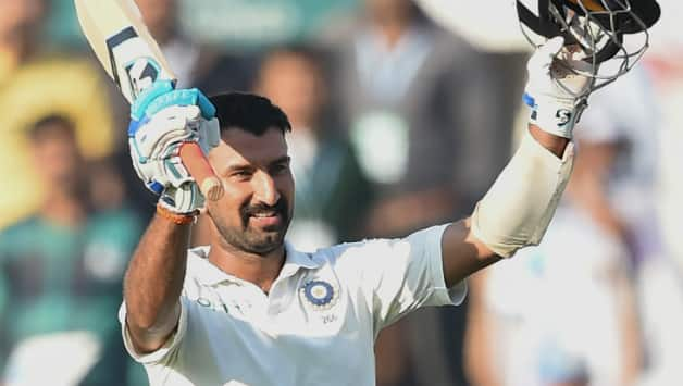 This was Pujara's 14th Test ton © AFP