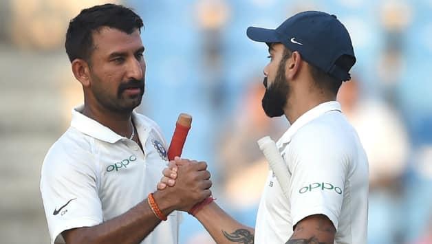 Kohli and Pujara have built an unbeaten 96-run partnership © AFP