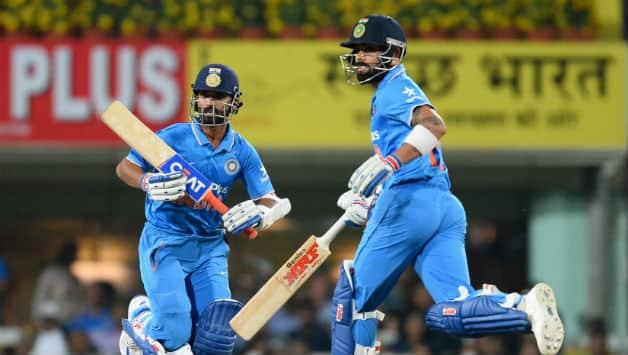 Rahane bats with Kohli (l) © AFP
