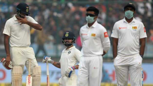 On Day 2 of the Test Sri Lankan players walked out after lunch, in masks (Image courtesy: AFP)