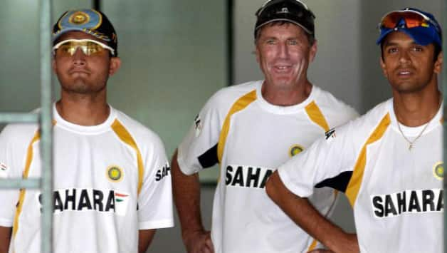 From left: Sourav Ganguly, John Wright and Rahul Dravid © AFP