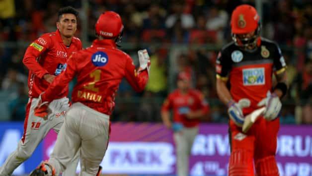 Mujeeb Zadran celebrates the wicket of Virat Kohli © AFP