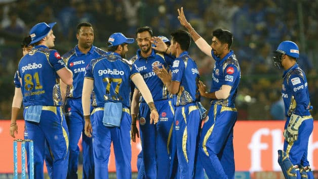 Krunal Pandya celebrates with MI teammates after fall of Rahul Tripathi's wicket © AFP