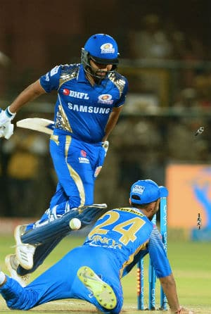 Rohit Sharma was run out for 0 by Ajinkya Rahane  © AFP