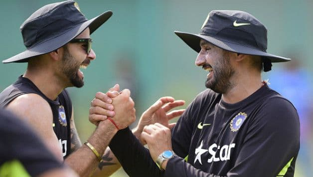 Virat Kohli (left) and Harbhajan Singh © AFP