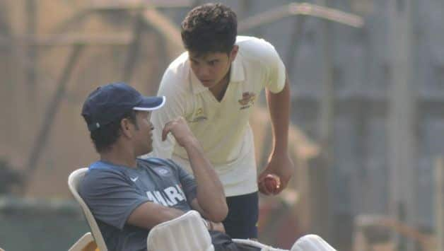 Sachin Tendulkar with Arjun Tendulkar © IANS