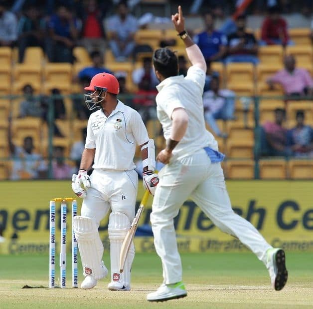 Umesh Yadav traps Mohammad Nabi leg-before; his three-wicket burst in the second innings pushed the Afghans further back © AFP