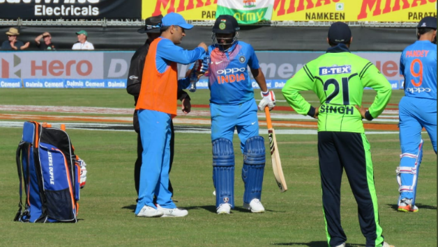 MS dhoni brings drinks for Suresh Raina during 2nd T20I against Ireland