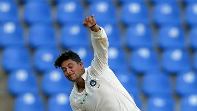 Kuldeep in his follow through © AFP