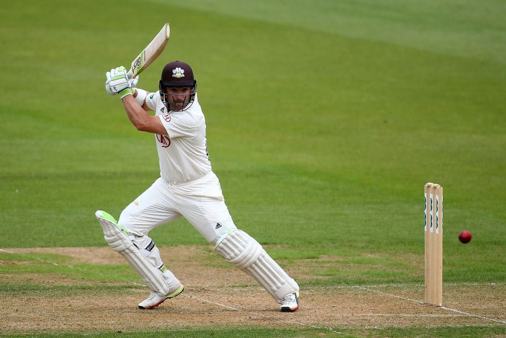 Surrey boosted by return of Dean Elgar in County Championship title race