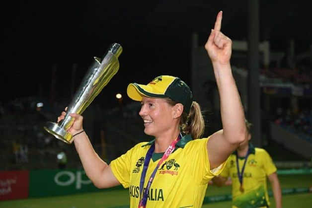 Australia captain Meg Lanning celebrates with the ICC Women's World T20 trophy on Saturday. @ Getty Images