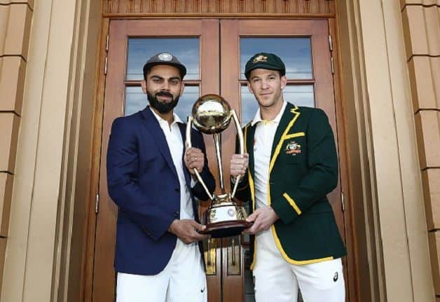 India captain Virat Kohli and his Australian counterpart Tim Paine pose with the Border-Gavaskar trophy at Adelaide on Wednesday. @ Getty Images