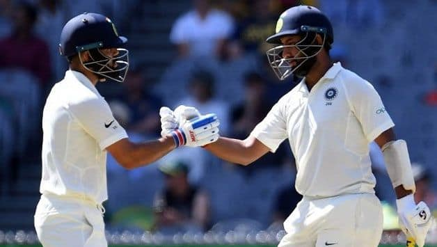 India consolidate in another wicketless session