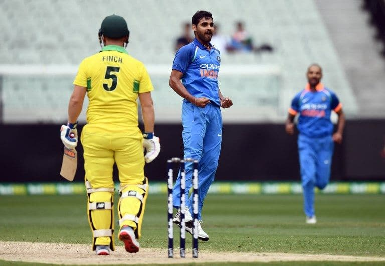 Bhuvneshwar Kumar celebrates getting Aaron Finch at the MCG.