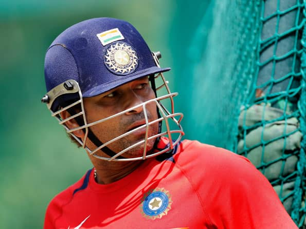 Relaxed Sachin Tendulkar plays football during India's practice session