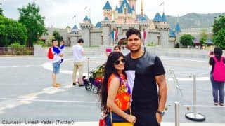 Umesh Yadav takes a picture with wife Tanya outside Disneyland