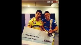 Ashish Nehra shares his Man of the Match award with Mike Hussey