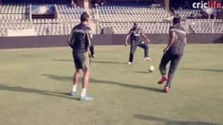 The Knights warm-up with a game of 'football-volleyball'