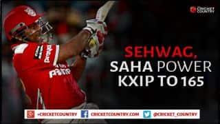 Virender Sehwag, Wriddhiman Saha guide Kings XI Punjab to 165 for 7 against Delhi Daredevils in IPL 2015