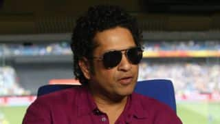 Sachin Tendulkar poses with Charlie Chaplin statue in Leicester Square