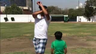 Photo: Wasim Akram imparts bowling tips to six-year-old