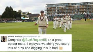Mitchell Johnson and other cricketers congratulate Chris Rogers on his retirement from First-Class cricket