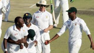 Zimbabwe stay in the game with two late wickets