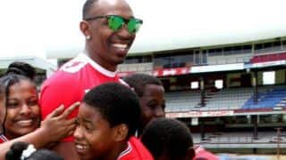 PHOTO: Dwayne Bravo posing with children during Trinidad and Tobago Red Steel practice