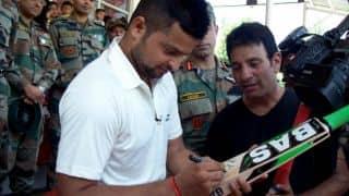Suresh Raina gifts Aditya Garhwal an autographed bat