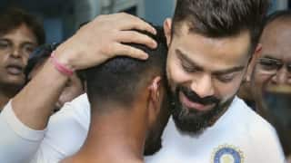 Virat Kohli embraces fan with jersey number, achievements tattooed on his body