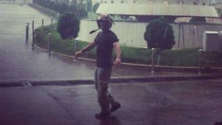 MS Dhoni enjoys bike ride in rain at Ranchi