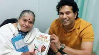 Sachin Tendulkar presents first copy of autobiography 'Playing It My Way' to mother