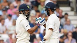 Lunch report: Kohli, Pujara take India forward after Broad nails two